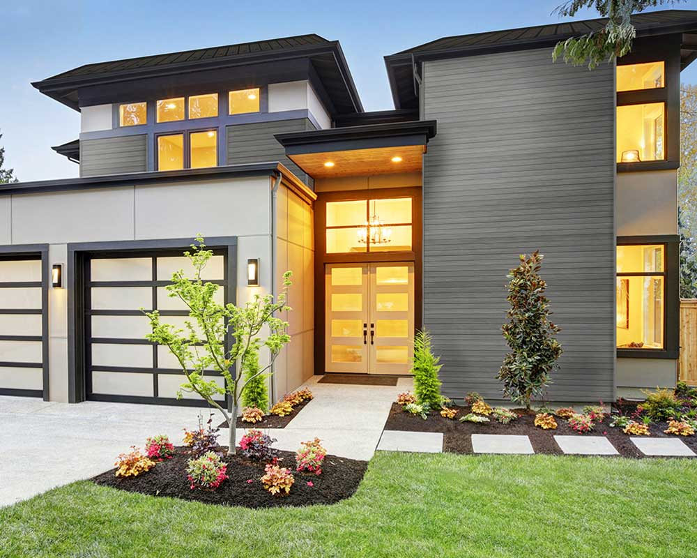 exterior of modern home with lights turned on