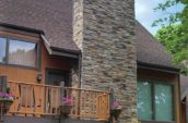 exterior of home with versetta stone chimney