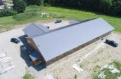 aerial exterior of long building with new metal roof