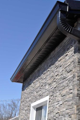 black eavestroughs on exterior of home