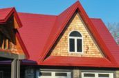 close up of red tile shingles on roof